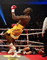 Adonis Stevenson celebrates his victory in the fifth round against Dmitri Sukhotskiy during the WBC light heavyweight championship fight Friday, December 19, 2014 at the Pepsi Colisee in Quebec City. THE CANADIAN PRESS/Jacques Boissinot
