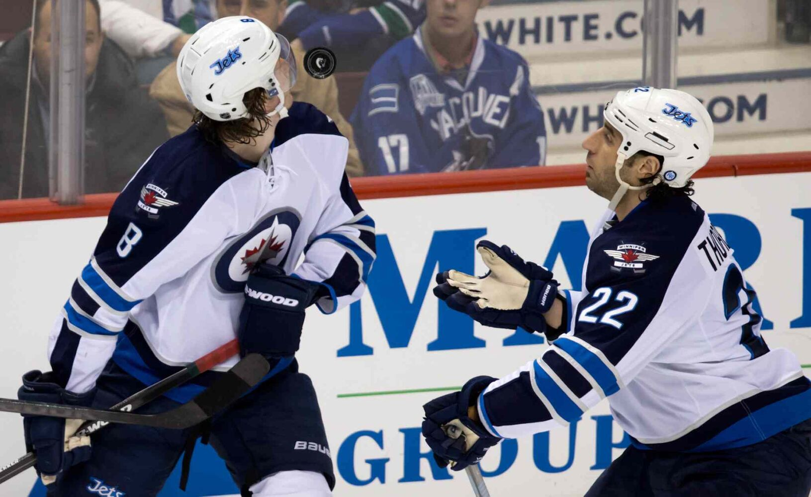 Winnipeg Jets defenceman Jacob Trouba (left) and Chris Thorburn watch an airborne puck during the second period.