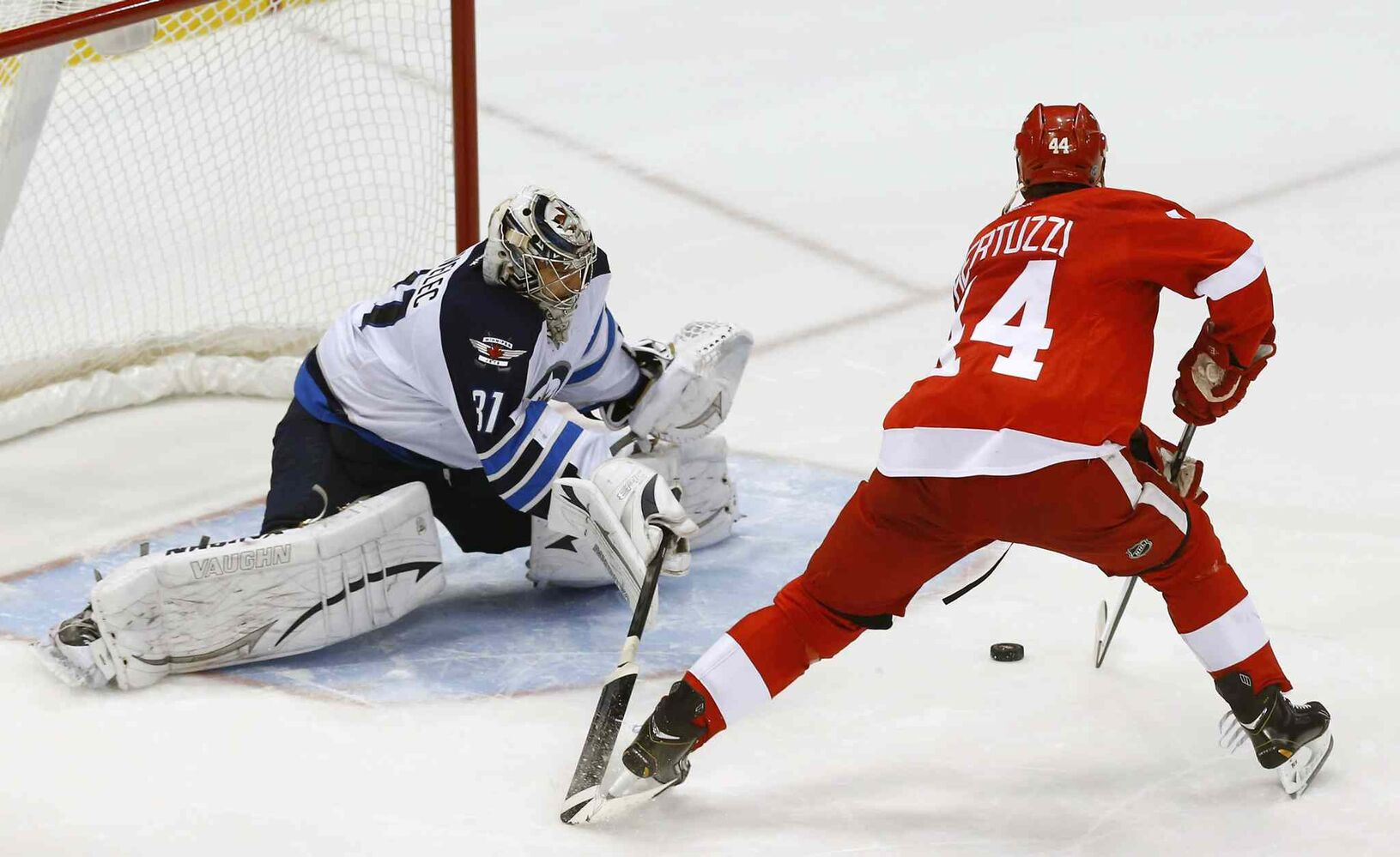 Winnipeg Jets goalie Ondrej Pavelec stops Detroit Red Wings forward Todd Bertuzzi's shootout attempt.