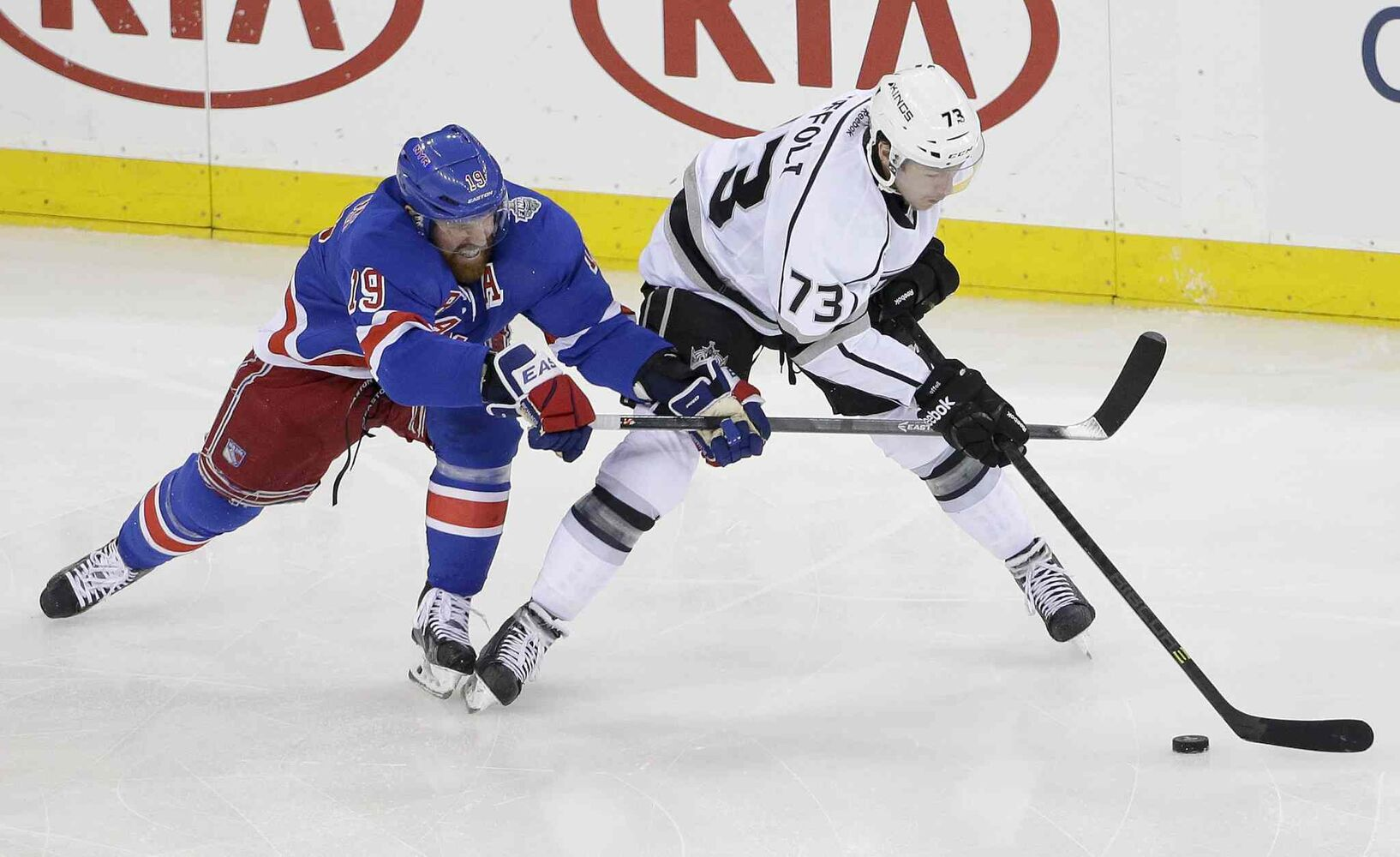 New York Rangers' centre Brad Richards (19) vies for the puck against Los Angeles Kings' centre Tyler Toffoli (73) in the first period of Wednesday's game. (Frank Franklin II / The Associated Press)