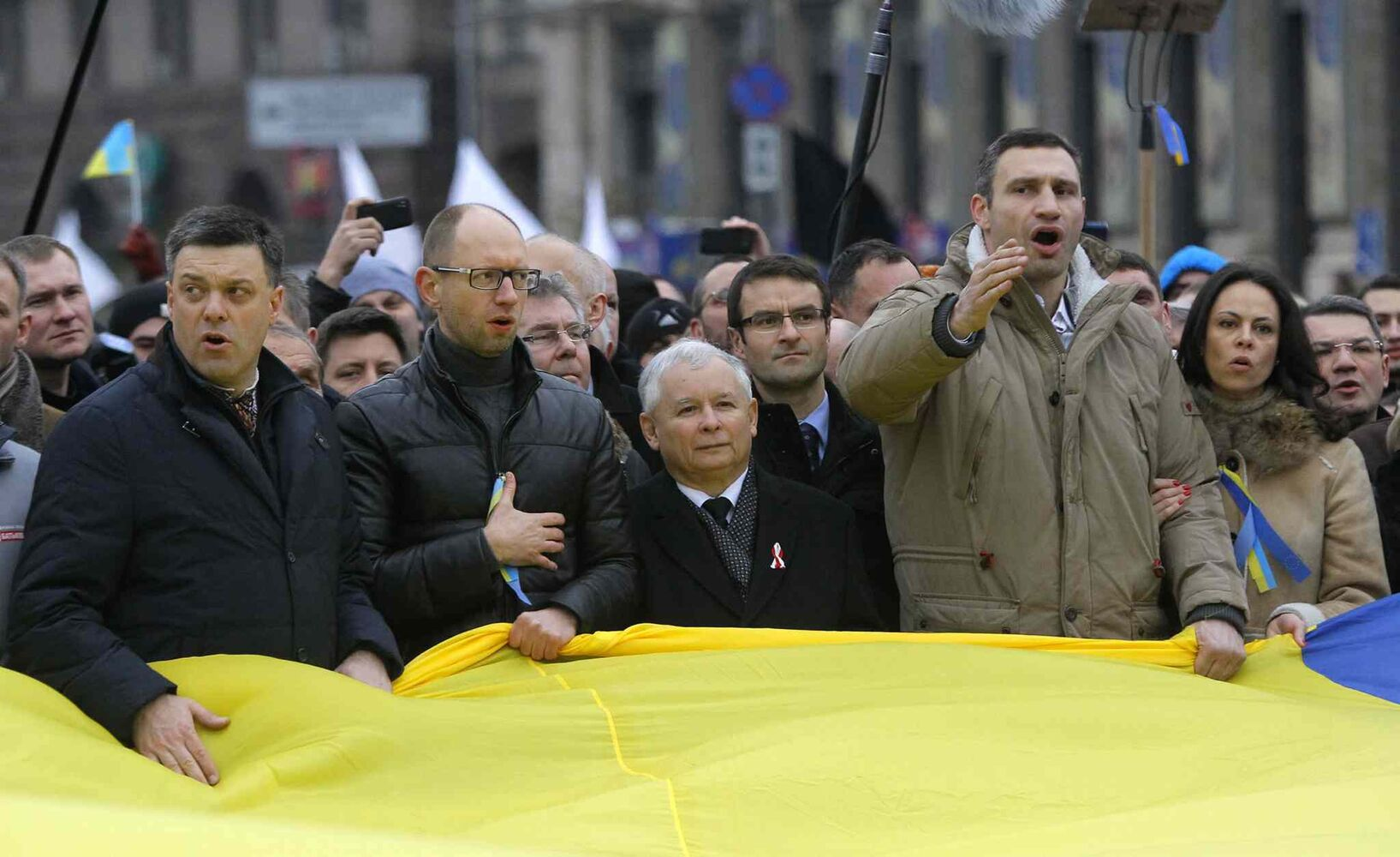 Lawmaker and chairman of the Ukrainian opposition party Udar (Punch), WBC heavyweight boxing champion Vitali Klitschko (right), is flanked by Polish politician Jaroslaw Kaczynski as they march during a rally in downtown Kiev, Ukraine, on Sunday. As many as 100,000 demonstrators chased away police to rally in the center of Ukraine's capital on Sunday, defying a government ban on protests on Independence Square, in the biggest show of anger over the president's refusal to sign an agreement with the European Union.  (Sergei Grits / The Associated Press)