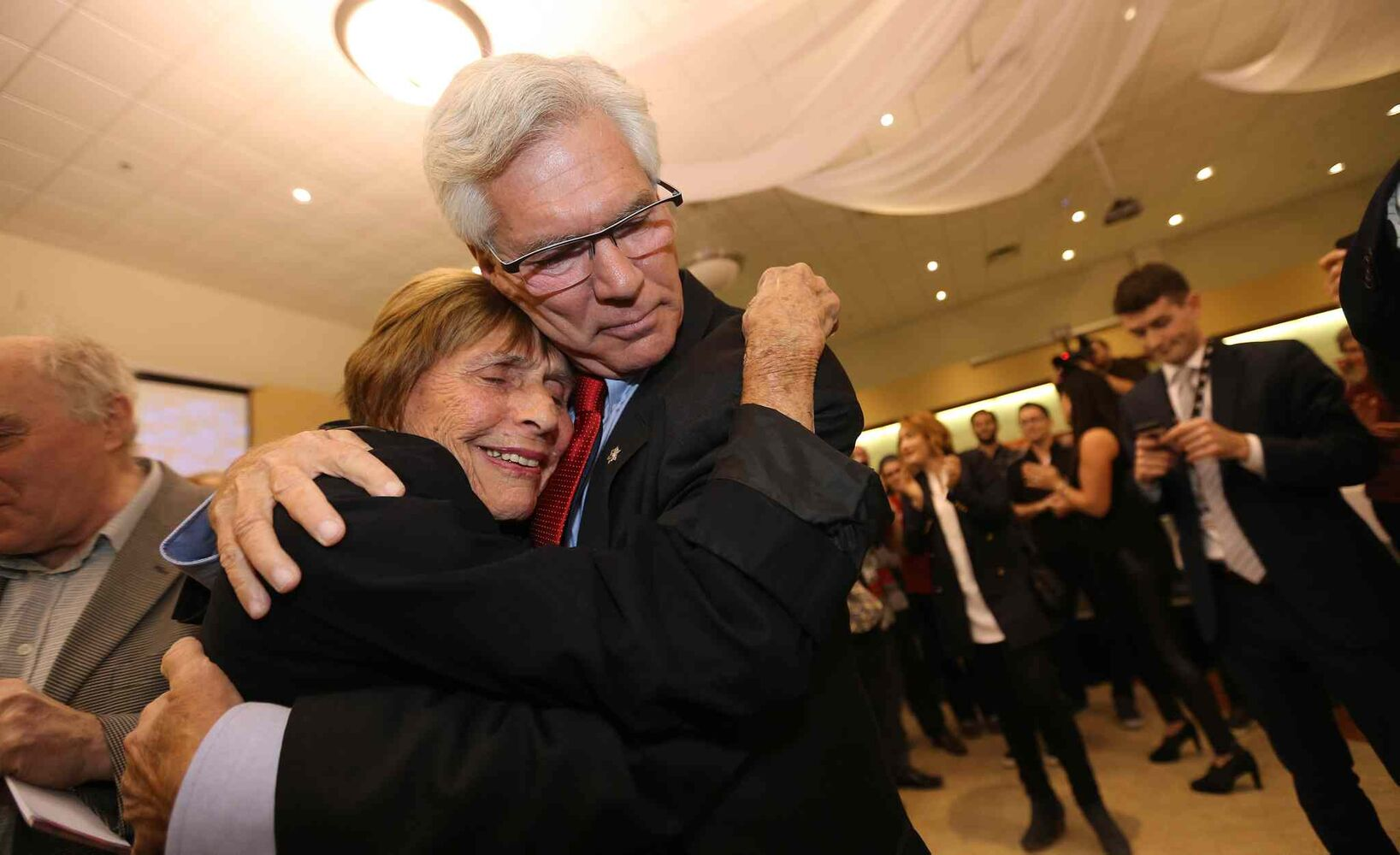 Jim Carr embraces his aunt, Frances Miles at his election victory party at the Caboto Centre, Monday, October 19, 2015. (TREVOR HAGAN/WINNIPEG FREE PRESS)