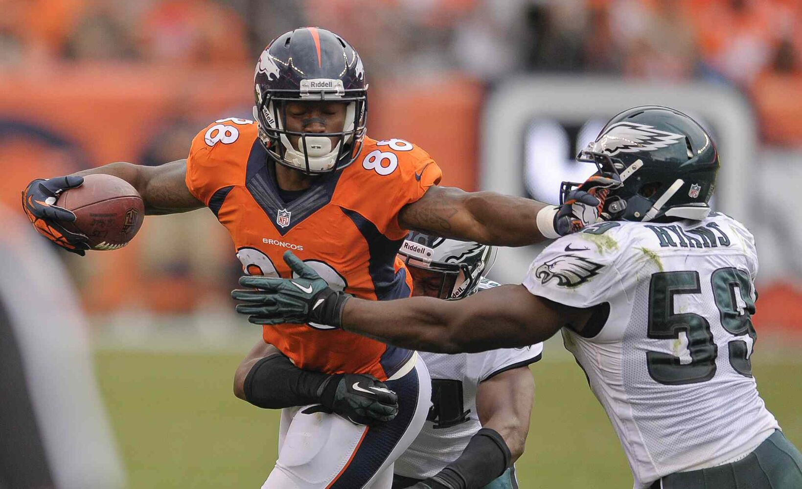 Denver Broncos wide receiver Demaryius Thomas (left) stiff arms Philadelphia Eagles linebacker DeMeco Ryans during the Broncos 52-20 win in Denver on Sunday. (Jack Dempsey / The Associated Press)