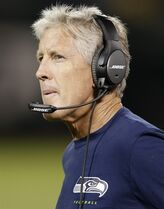 Seattle Seahawks coach Pete Carroll watches from the sideline during the second half of an NFL preseason football game against the Oakland Raiders in Oakland, Calif., Thursday, Aug. 28, 2014. (AP Photo/Marcio Jose Sanchez)