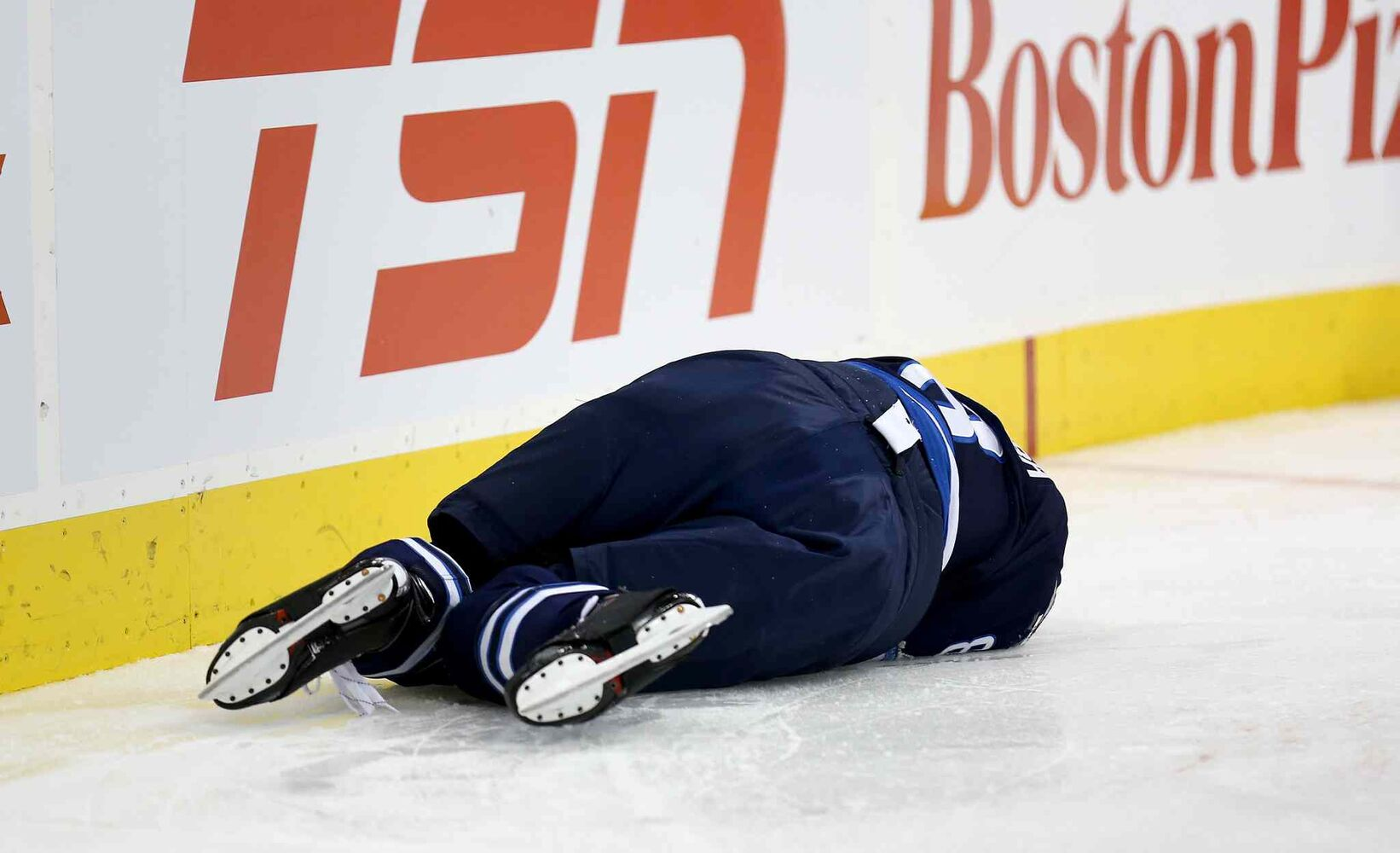 Winnipeg Jets' Jacob Trouba lays on the ice after hitting the boards head-first. (TREVOR HAGAN / WINNIPEG FREE PRESS)