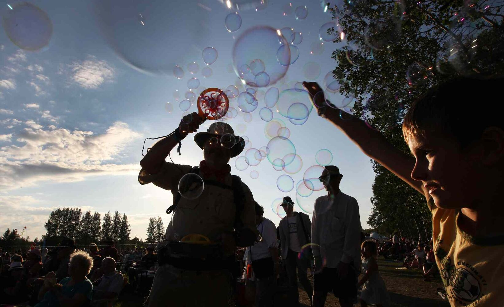 Children follow 'The Bubbleman'  at the Winnipeg Folk Festival Friday. (Joe Bryksa / Winnipeg Free Press)
