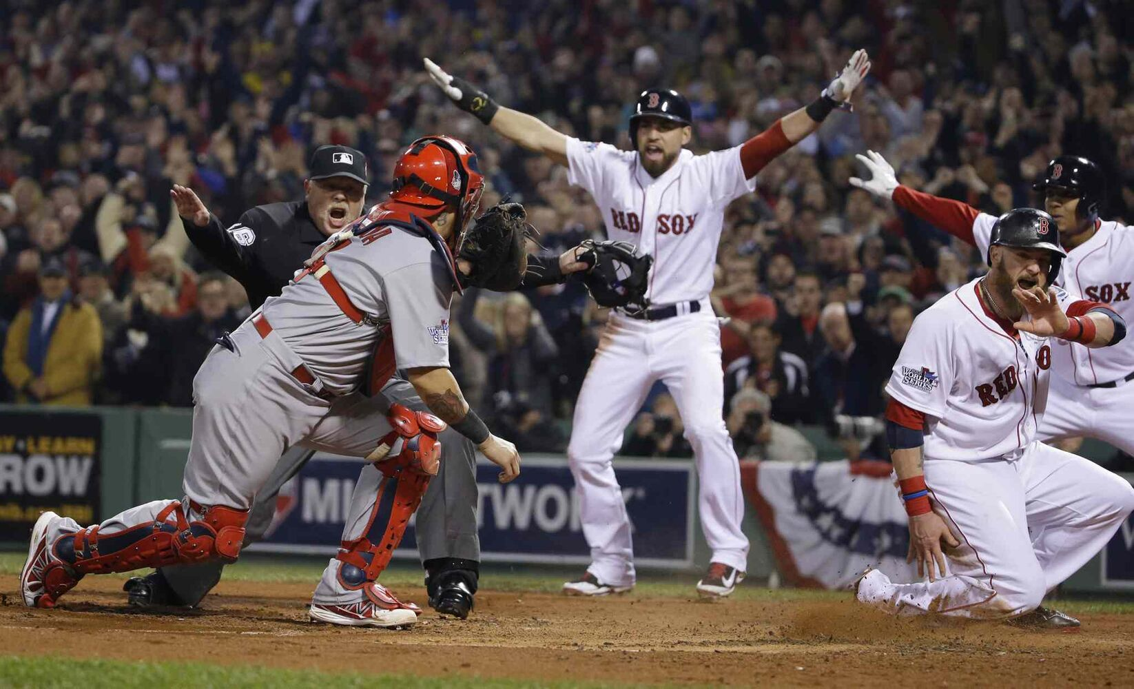 St. Louis Cardinals catcher Yadier Molina looks back as home plate umpire Adam Wainwright call Boston Red Sox's Jonny Gomes safe on a three-run RBI double by Shane Victorino. (Matt Slocum / The Associated Press)