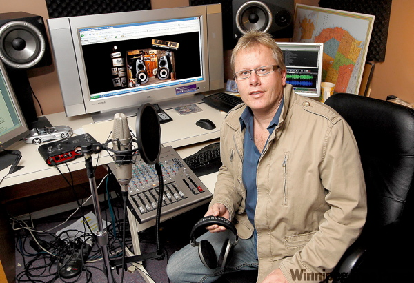 Howard Kroeger, shown in his studio, does radio station programming for over 20 stations from his home in La Salle.