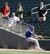 Texas Rangers right fielder Nate Schierholtz can't make the catch on a foul ball hit by Oakland Athletics' Craig Gentry in the third inning of a spring training exhibition baseball game Friday, March 27, 2015, in Mesa, Ariz. (AP Photo/Ben Margot)