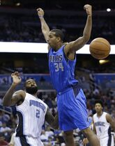 Dallas Mavericks' Brandan Wright (34) loses control of the ball while going in for a shot as he is fouled by Orlando Magic's Kyle O'Quinn (2) during the first half of an NBA preseason basketball game in Orlando, Fla., Friday, Oct. 24, 2014. (AP Photo/John Raoux)