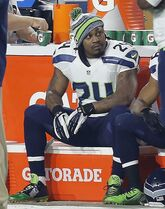 FILE - In this Dec. 21, 2014, file photo, Seattle Seahawks running back Marshawn Lynch watches from the sideline during the first quarter of an NFL football game against the Arizona Cardinals in Glendale, Ariz. No more Skittles, no more Beast Mode and no more avoiding the media. Is it possible that Lynch will retire after the Super Bowl? (AP Photo/Rick Scuteri, File)