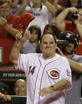 FILE - In this Sept. 6, 2013, file photo, former Cincinnati Red great Pete Rose walks onto the field during ceremonies honoring the starting eight of the 1975-76 World Champion Reds following a baseball game between the Cincinnati Reds and the Los Angeles Dodgers in Cincinnati. Major League Baseball Commissioner Rob Manfred said Thursday, April 23, 2015, that Rose will play some role during this summer's All-Star Game in Cincinnati. (AP Photo/Al Behrman, File)