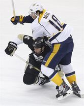 Pittsburgh Penguins' Rob Scuderi, bottom, upends Nashville Predators' James Neal (18) in the first period of an NHL hockey game, Sunday, Feb. 1, 2015 in Pittsburgh. (AP Photo/Keith Srakocic)