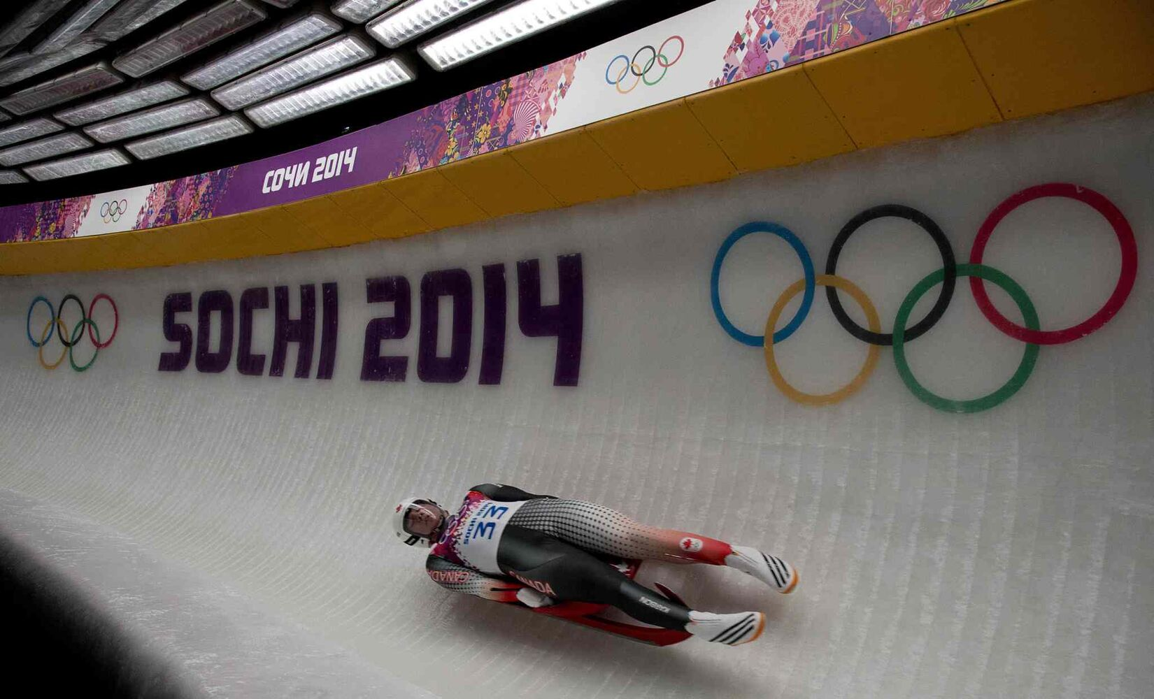 Canada's Mitchel Malyk, of Calgary, races in the third run of the men's single luge at the Sochi Winter Olympics. (Jonathan Hayward / The Canadian Press)