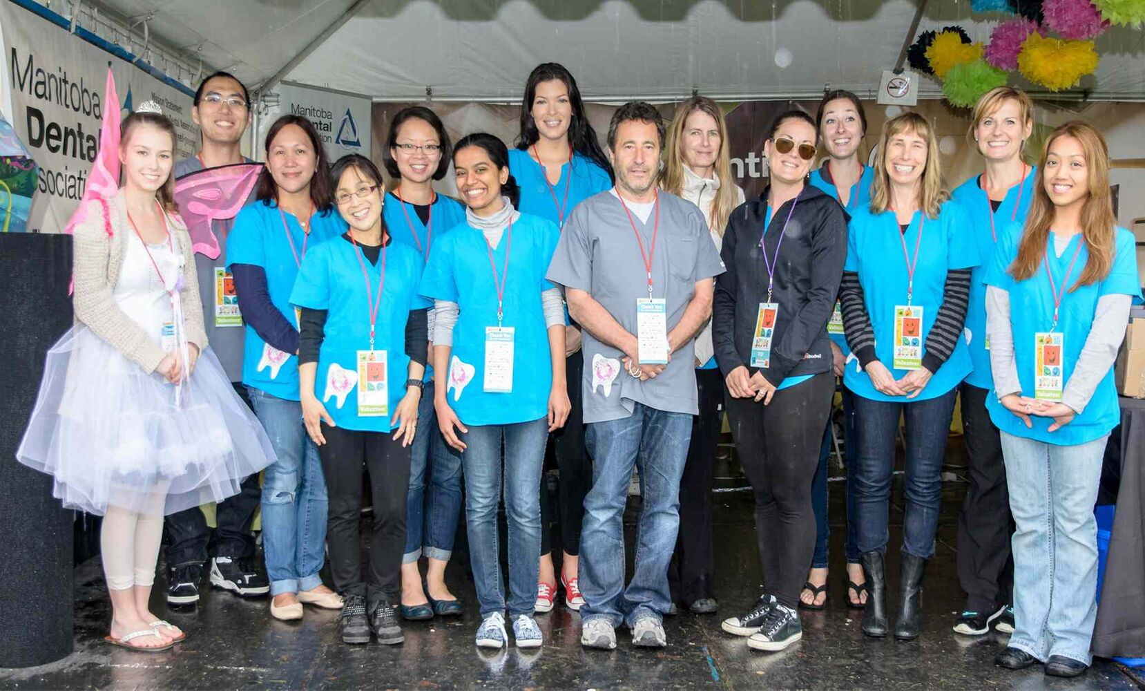 The Manitoba Dental Association (MDA) was out in full force at the Winnipeg International Children's Festival at The Forks on June 6, 2015. Volunteer dentists and dental assistants saw more than 300 children. The MDA has been running Tooth Fairy Saturday at the festival since 1996. Pictured, from left, are Alyssa Malenki (Healthy Smile, Happy Child program), Brandon Wang, Alhena Root, Dr. Tricia Magsino-Barnabe, Dr. Susan Tsang, Trisha Mambalum-Mahendra, Whitney Taylorson, Dr. Mark Nepon, Sarah Laidlaw, Tammy Hildebrand (director of member and public relations, MDA), Dr. Jacqueline Samborski, Edith Diner, Crystal Sabourin and Christine Mallari.