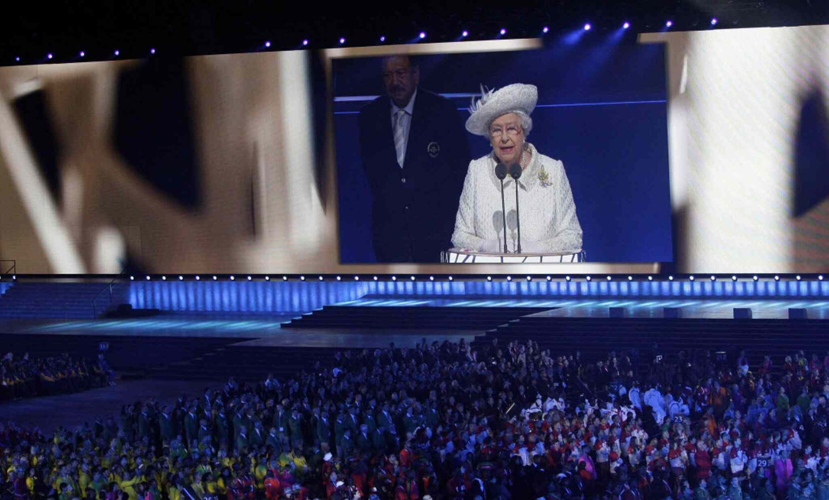 Britain's Queen Elizabeth II is seen on a large video screen as she speaks during the opening ceremony for the Commonwealth Games 2014 in Glasgow, Scotland. (Kirsty Wigglesworth / The Associated Press)