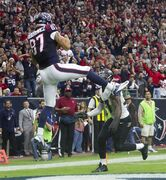 Houston Texans tight end C.J. Fiedorowicz catches a 5-yard touchdown pass during an NFL football game against the Baltimore Ravens, Sunday, Dec. 21, 2014, in Houston. (AP Photo/Conroe Courier, Jason Fochtman)