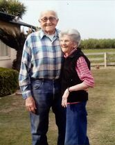 In this March 2014 photo provided by Cynthia Letson, Floyd and Violet Hartwig pose together in a yard in Easton, Calif. The Hartwig's marriage spanned 67 years, but their love for one another appears timeless. Sensing that the couple was close to death, their children pushed their two hospice beds together and gently placed their father's hand in the mother's palm. Floyd, 90, died first. Violet, 89, followed five hours later. They had a good life and died Feb. 11, 2015, at home, just as they had wished, the family said. (AP Photo/Cynthia Letson)