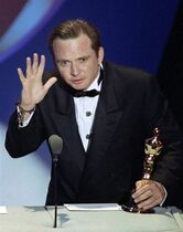 FILE - This March 26, 1991 file photo shows Michael Blake accepting the Oscar for best adapted screenplay for