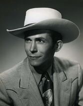 In this undated photo released by the Country Music Hall of Fame, country music artist Hank Williams is shown. Previously unreleased recordings of country music legend Hank Williams performing songs on a 1950 radio show will be released next month for download and on vinyl.