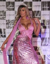 FILE - In this Nov. 30, 2012 file photo, Andressa Urach competes in the Miss Bumbum Brazil contest in Sao Paulo, Brazil. The 27-year-old Urach, arguably Brazil's most outspoken advocate of advancement through cosmetic surgery, went into septic shock on Dec. 1, 2014 and was placed on life support after a botched operation to augment her thighs, sparking a debate about the risks Brazilian women will take for beauty at a moment when the nation has surpassed the U.S. as the world's plastic surgery capital. (AP Photo/Nelson Antoine, File)