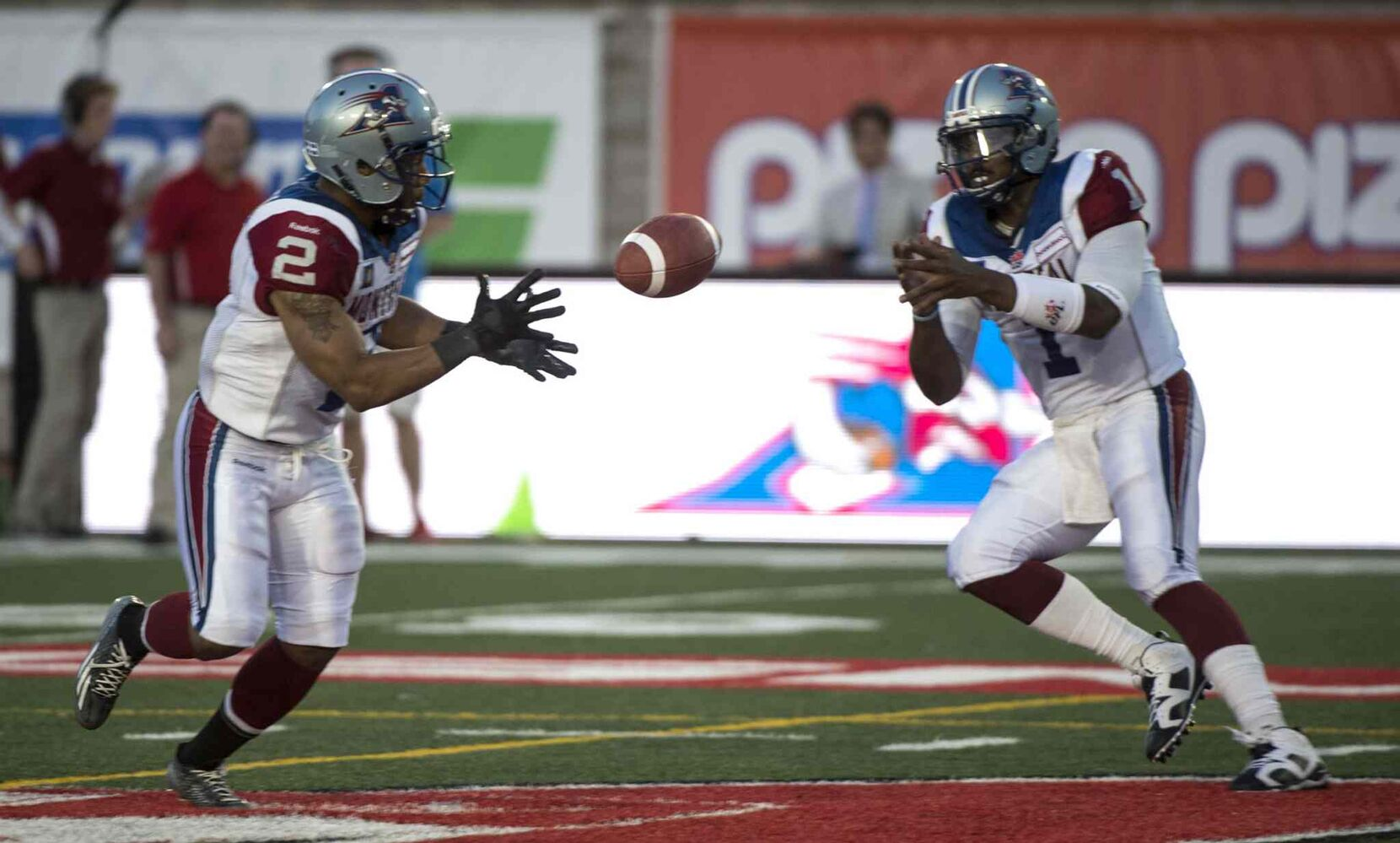 Montreal Alouettes' quarterback Troy Smith lobs the ball to teammate Brandon Whitaker as they face the Winnipeg Blue Bombers during the second quarter.