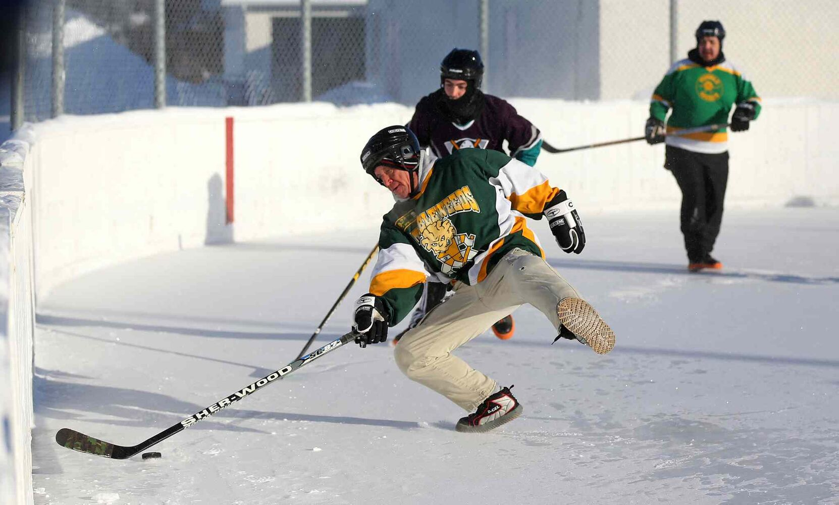 The Tumbleweeds' Colin Mackenzie loses his footing while playing against the Mighty Puckin' Drunks during a spongee game on Jan. 4, 2014. (Trevor Hagan / Winnipeg Free Press)