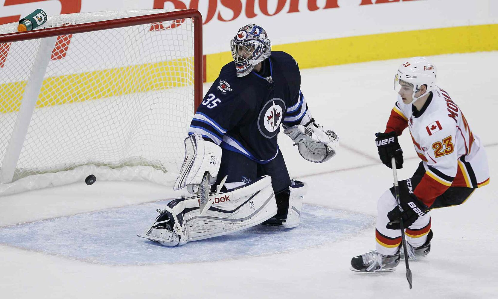 Calgary Flames' Sean Monahan (23) scores on Winnipeg Jets' goaltender Al Montoya (35) in the shootout to win in NHL action in Winnipeg on Monday, Nov. 18, 2013.