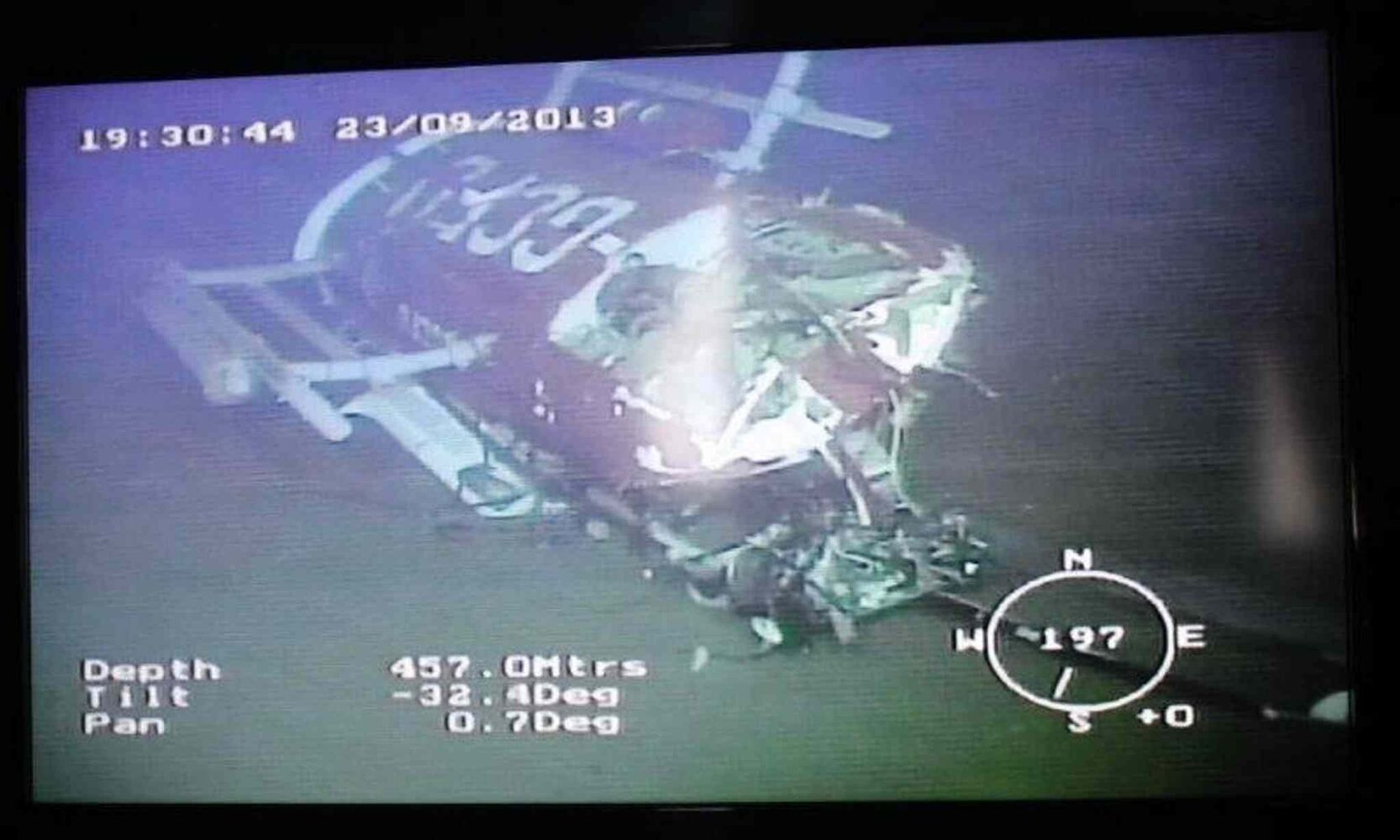 The sunken helicopter wreckage captured underwater by ArcticNet's Remote Operated Vehicle (ROV)  (Transportation Safety Board of Canada )