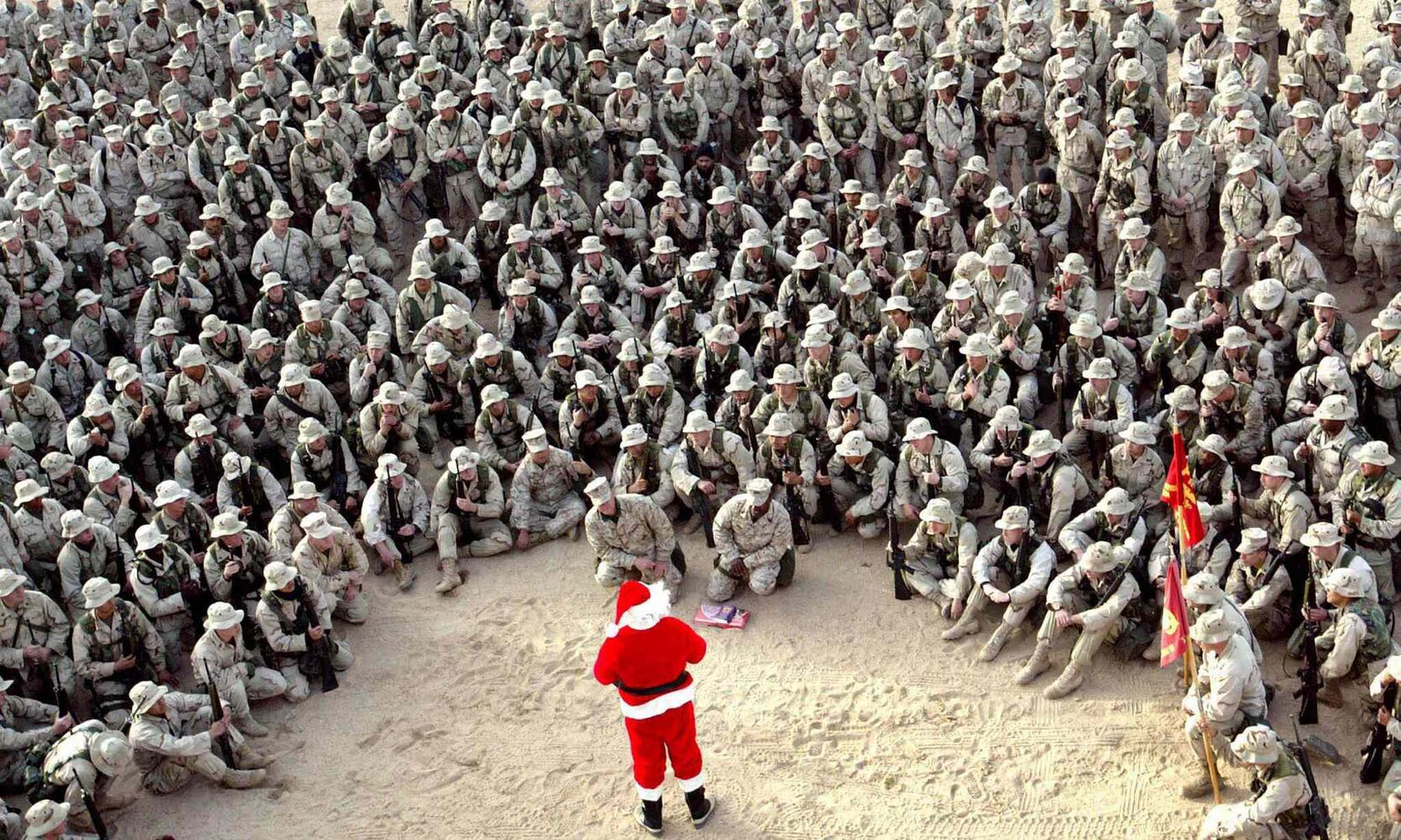Dec. 24, 2002:  Hundreds of U.S. Marines gather at Camp Commando in the Kuwait desert during a Christmas Eve visit by Santa Claus.