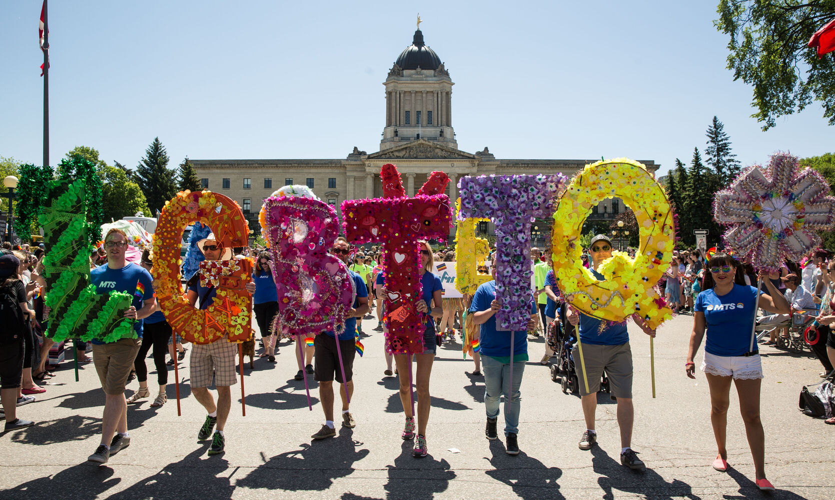Participants in Sunday's Pride Parade spell out LGTBQ*.  (Mike Deal / Winnipeg Free Press)