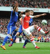 Arsenal's Olivier Giroud, center, is blocked by Chelsea's John Terry, left, and Cesar Azpilicueta during the English Premier League soccer match between Arsenal and Chelsea at the Emirates Stadium, London, England, Sunday, April 26, 2015. (AP Photo/Rui Vieira)