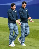 Europe's Rory McIlroy, left, and Martin Kaymer walk off after playing the 1st tee during a practice round ahead of the Ryder Cup golf tournament at Gleneagles, Scotland, Tuesday, Sept. 23, 2014. (AP Photo/Scott Heppell)