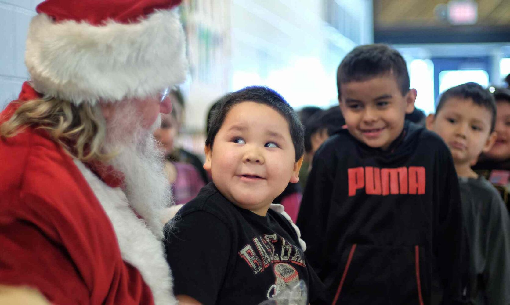 Jacoby Smith, 5, gives Santa a look as he talks to him during Santa's visit to Wanipigow School on the Hollow Water First Nation Wednesday.