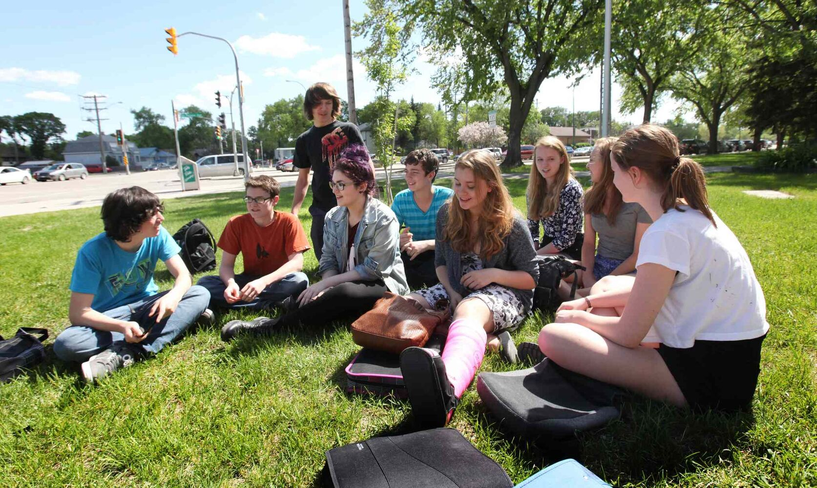 Former Windsor School students gather together on the front lawn in early June during the final days of their first year in high school at Glenlawn Collegiate.  From left: Thomas, Noah, Garrett, Shelby, Quinn, Mackenzie, Hailey, Aby and Sydney.   (RUTH BONNEVILLE / WINNIPEG FREE PRESS)