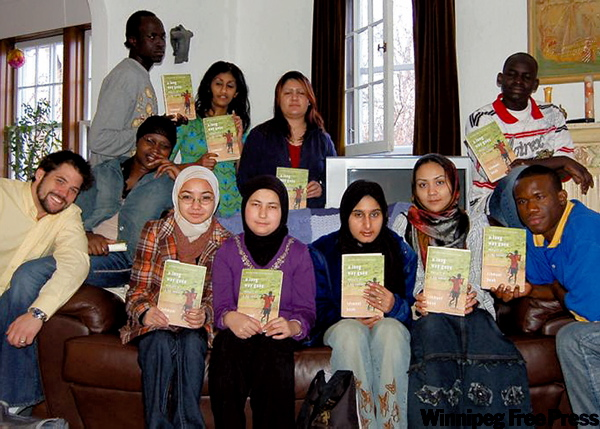 Kuly (front left) and his Gordon Bell students with their copies of Ishmael Beah's A Long Way Gone.