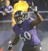 FILE - In this Nov. 10, 2013 file photo, Baltimore Ravens tackle Eugene Monroe waves as he introduced before an NFL football game against the Cincinnati Bengals, in Baltimore. With a new five-year contract, Monroe provides the Ravens with the kind of stability at left tackle they haven't had since Hall of Famer Jonathan Ogden retired. (AP Photo/Nick Wass, File)