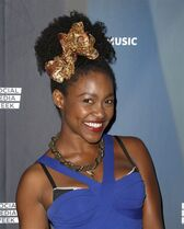 """FILE - In this Sept. 25, 2012 file photo, Daniele Watts attends a Janelle Monae concert at Club Nokia in Los Angeles. Watts, who suggested she was detained by Los Angeles police because of racial profiling after she was found in a parked car with her boyfriend has been charged with lewd conduct. The actress, who appeared in """"Django Unchained,"""" and Brian Lucas each were charged Tuesday, Oct. 21, 2014, with misdemeanor counts that carry potential six-month jail terms. (Photo by Todd Williamson/Invision/AP, File)"""