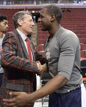 Craig Sager, left, gets a hug from Oklahoma City Thunder guard Dion Waiters, right, before the game between the Chicago Bulls and the Oklahoma City Thunder. Sager returns to broadcasting as a sideline reporter for TNT tonight at the Bulls game in Chicago. He's been out all season recovering from leukemia, Thursday, March 5, 2015. (AP Photo/David Banks)