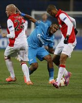 Zenit's Jose Rondon, center, is blocked by Monaco's Andrea Raggi, left, and Fabinho, right, as they struggle for the ball during the Champions League Group C soccer match between Zenit and Monaco at Petrovsky stadium in St.Petersburg, Russia, Wednesday Oct. 1, 2014. (AP Photo/Dmitry Lovetsky)