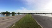 Rising Assiniboine river swallows portion of Brandon's First Street North