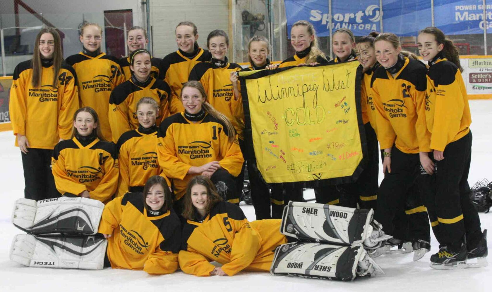 Winnipeg West Gold ringette team celebrates their gold win over team Interlake. (JOE BRYKSA / WINNIPEG FREE PRESS)