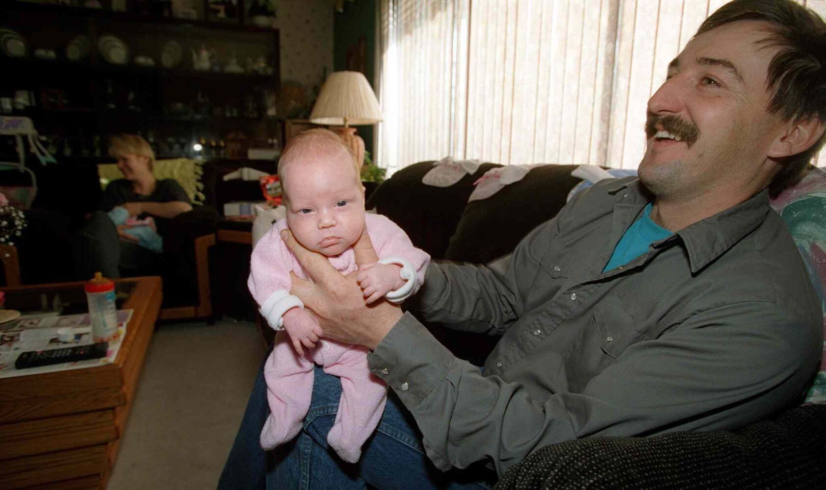 Ed Lavich reacts as Maryn burps after a feeding on Oct. 30, 1996.  (JEFF DE BOOY / WINNIPEG FREE PRESS FILES)