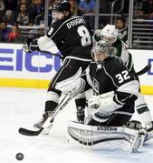 Los Angeles Kings goalie Jonathan Quick, keeps his eye on the puck during the third period of an NHL hockey game against the Minnesota Wild in Los Angeles on Sunday, Oct. 19, 2014. The Kings won 2-1. (AP Photo/Christine Cotter)