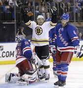 Bruins' Gregory Campbell celebrates Johnny Boychuk's tying goal in the third period, while Rangers goalie Henrik Lundqvist and defenceman Michael Del Zotto express opposite emotions. Boychuk's goal was followed by Daniel Paille potting the winner at 16:29.