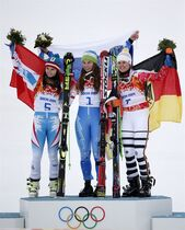 Women's giant slalom winners, from left, Austria's Anna Fenninger (silver), Slovenia's Tina Maze (gold) and Germany's Viktoria Rebensburg (bronze), pose for photographers on the podium at the Sochi 2014 Winter Olympics, Tuesday, Feb. 18, 2014, in Krasnaya Polyana, Russia. (AP Photo/Christophe Ena)