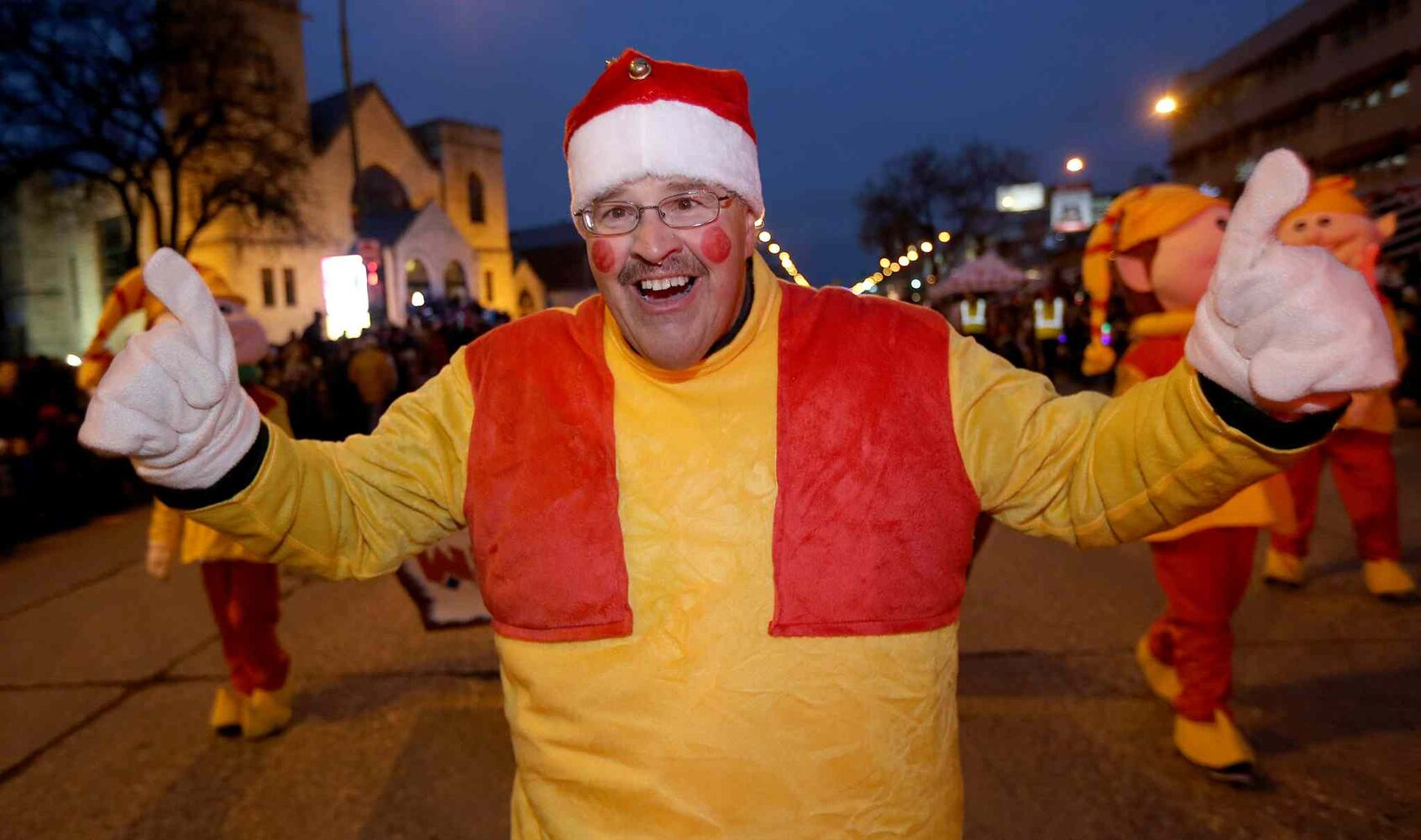 Dancing Gabe leads the Santa Claus Parade on Portage Avenue Saturday night. (TREVOR HAGAN / WINNIPEG FREE PRESS)