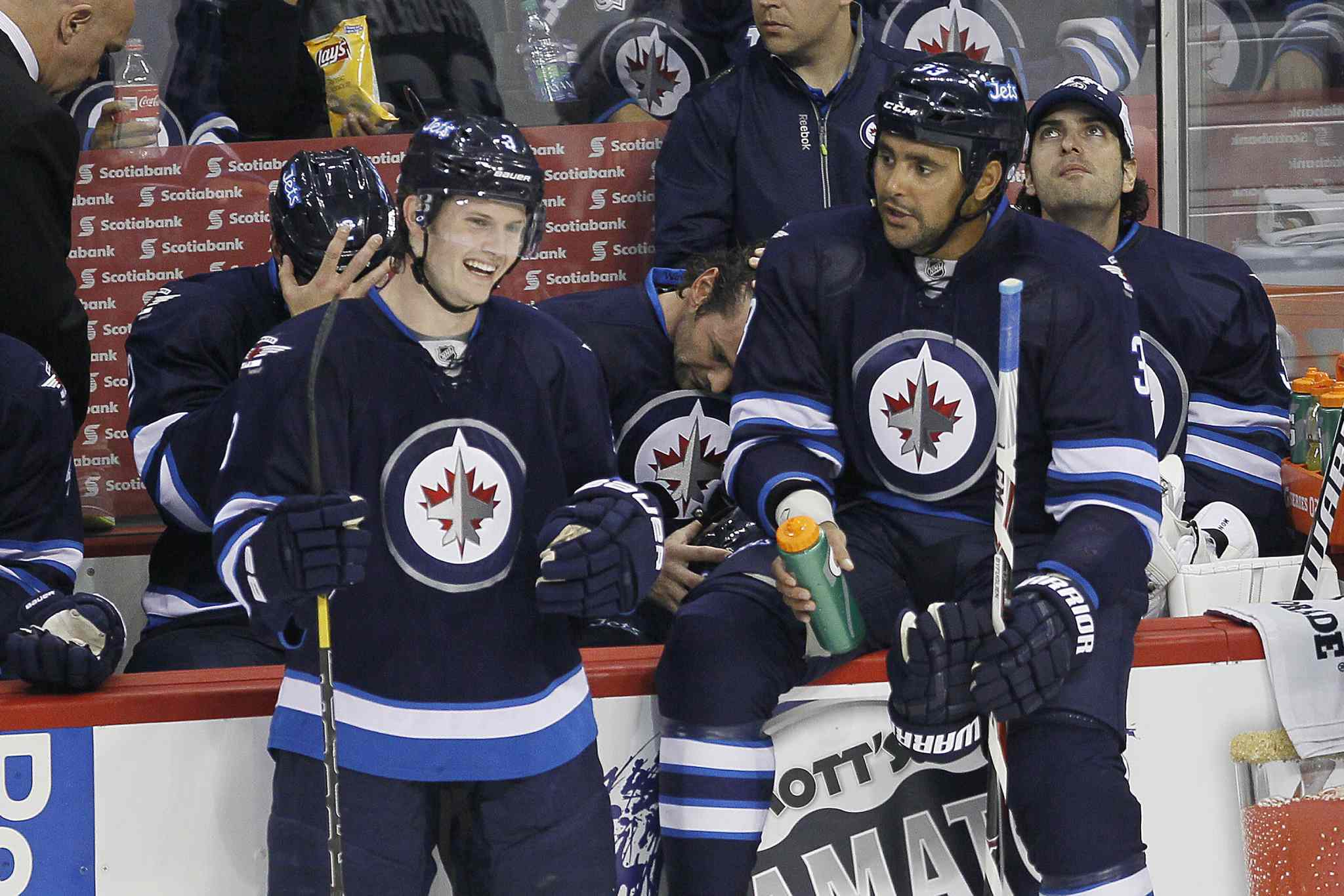 Winnipeg Jets' Jacob Trouba (left) and Dustin Byfuglien joke around during a commercial break.