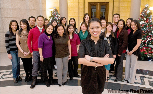 Joan Duhaylungsod (front) and other nursing recruits from the Philippines attend a ceremony at the Manitoba legislature on Thursday.