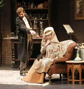 Sherlock Holmes (Jay Hindle) points the finger at Lillie Langtry (Sharon Bajer).